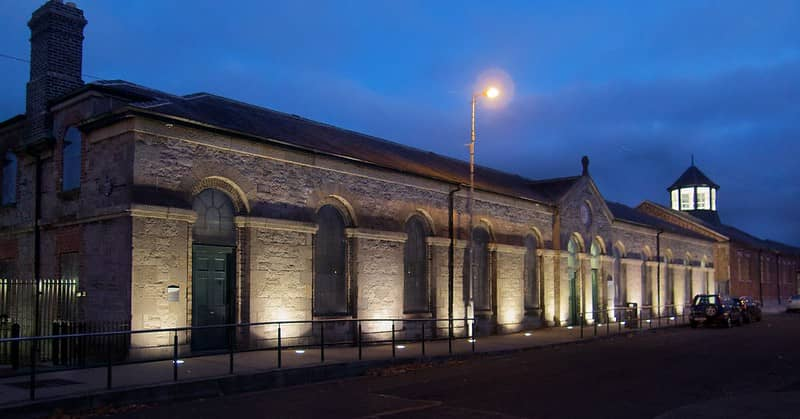 Richmond Barracks Dublin at night with uplights and the restored cupploa