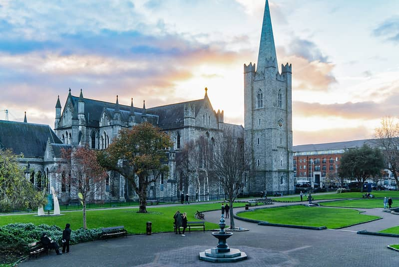 St patricks cathedral Dublin with the sun setting behind